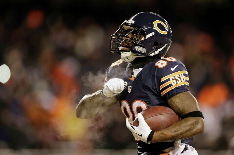 Chicago Bears wide receiver Earl Bennett (80) celebrates after making a touchdown reception during the first half of an NFL football game against the Dallas Cowboys, Monday, Dec. 9, 2013, in Chicago. (AP Photo/Nam Y. Huh) Photo: Nam Y. Huh, Associated Press / AP