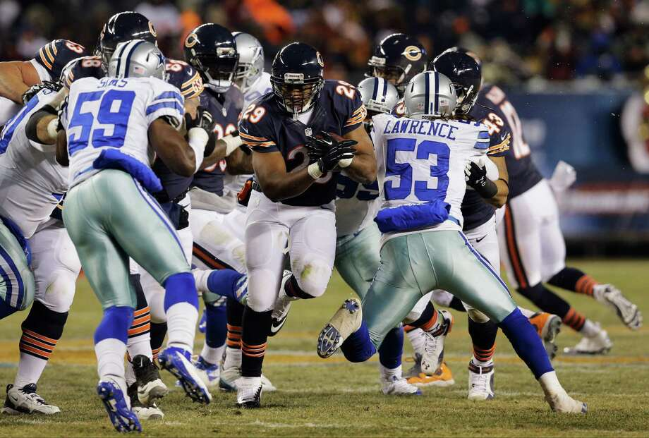 Chicago Bears running back Michael Bush (29) rushes against Dallas Cowboys defenders during the second half of an NFL football game, Monday, Dec. 9, 2013, in Chicago. (AP Photo/Nam Y. Huh) Photo: Nam Y. Huh, Associated Press / AP