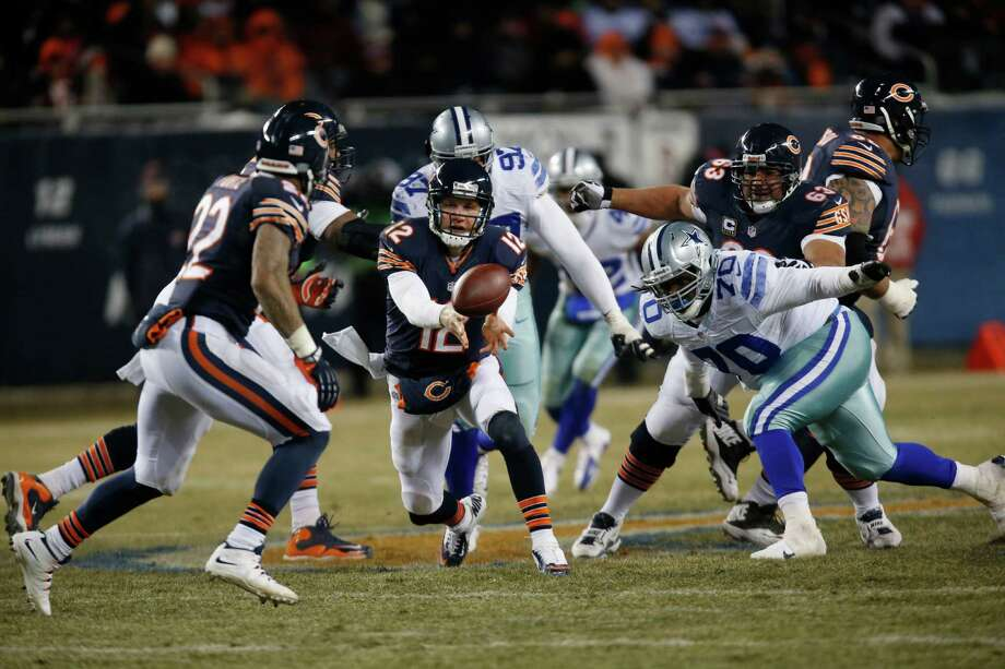 Chicago Bears quarterback Josh McCown (12) pitches the ball to running back Matt Forte (22) during the second half of an NFL football game against the Dallas Cowboys, Monday, Dec. 9, 2013, in Chicago. (AP Photo/Charles Rex Arbogast) Photo: Charles Rex Arbogast, Associated Press / AP