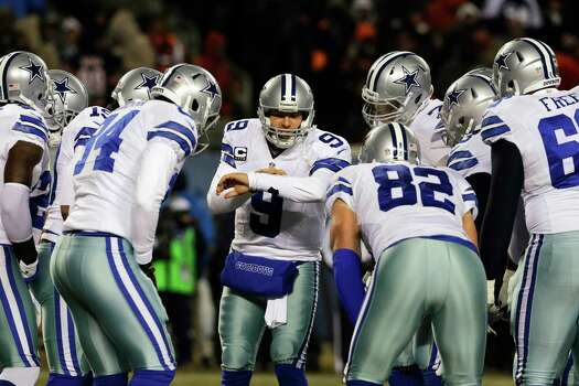 Dallas Cowboys quarterback Tony Romo (9) calls a play in the huddle during the first half of an NFL football game against the Chicago Bears, Monday, Dec. 9, 2013, in Chicago. (AP Photo/Nam Y. Huh) Photo: Nam Y. Huh, Associated Press / AP