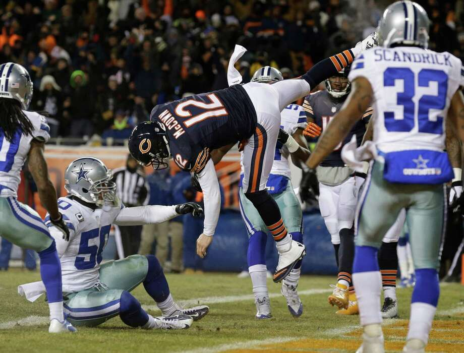 Chicago Bears quarterback Josh McCown (12) gets hit by Dallas Cowboys linebacker Sean Lee (50) in the air as McCown makes a touchdown run during the first half of an NFL football game, Monday, Dec. 9, 2013, in Chicago. (AP Photo/Nam Y. Huh) Photo: Nam Y. Huh, Associated Press / AP