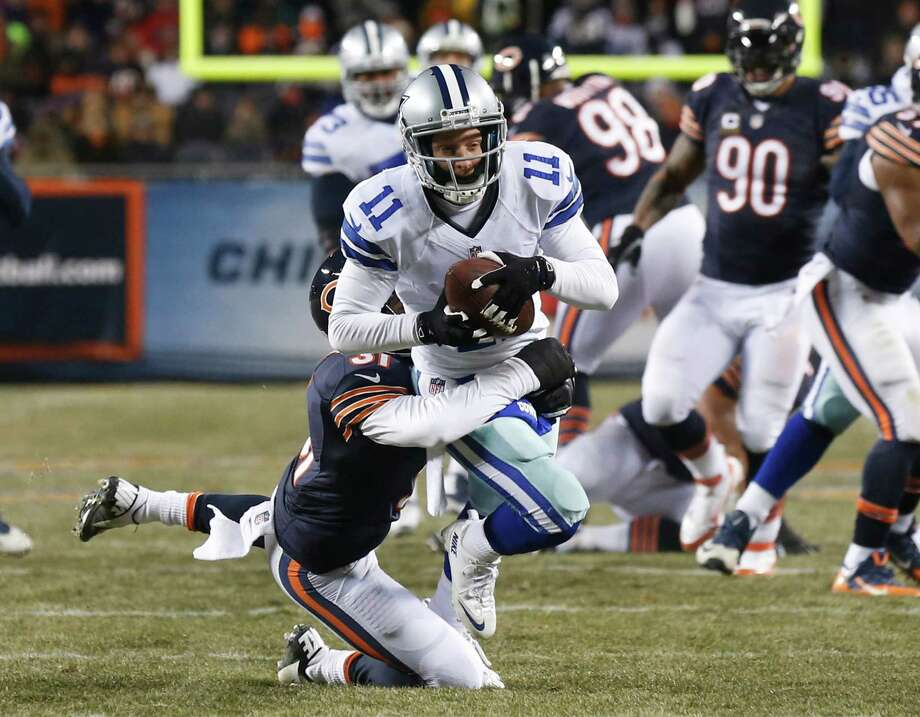 Chicago Bears cornerback Isaiah Frey tackles Dallas Cowboys wide receiver Cole Beasley (11) during the first half of an NFL football game, Monday, Dec. 9, 2013, in Chicago. (AP Photo/Charles Rex Arbogast) Photo: Charles Rex Arbogast, Associated Press / AP