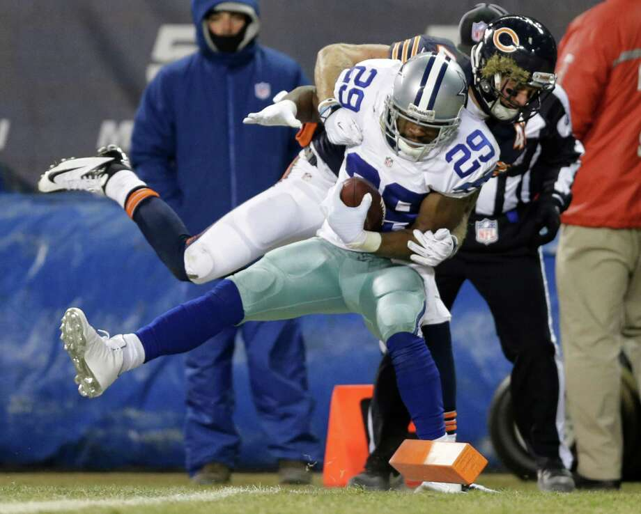 Chicago Bears safety Chris Conte pulls Dallas Cowboys running back DeMarco Murray (29) out of bounds before the end zone during the first half of an NFL football game, Monday, Dec. 9, 2013, in Chicago. (AP Photo/Nam Y. Huh) Photo: Nam Y. Huh, Associated Press / AP