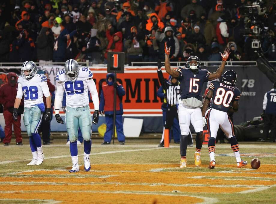 Chicago Bears wide receiver Brandon Marshall (15) celebrates after making a catch for a two-point conversion during the second half of an NFL football game against the Dallas Cowboys, Monday, Dec. 9, 2013, in Chicago. (AP Photo/Charles Rex Arbogast) Photo: Charles Rex Arbogast, Associated Press / AP