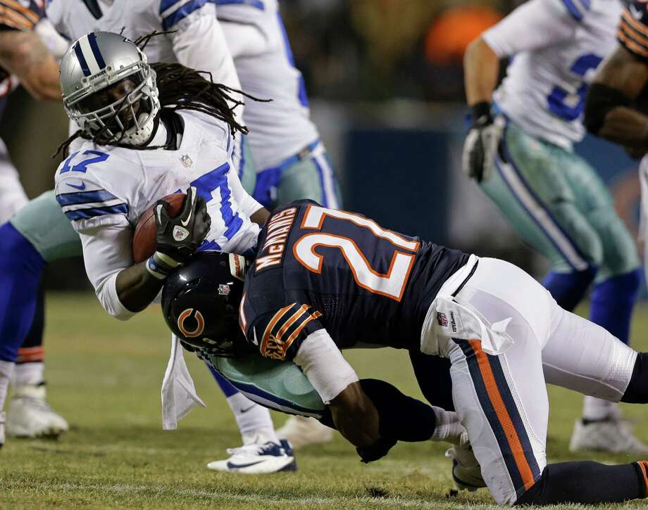 Chicago Bears cornerback Sherrick McManis (27) tackles Dallas Cowboys wide receiver Dwayne Harris (17) during the first half of an NFL football game, Monday, Dec. 9, 2013, in Chicago. (AP Photo/Nam Y. Huh) Photo: Nam Y. Huh, Associated Press / AP