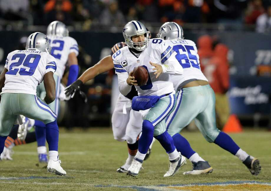 Dallas Cowboys quarterback Tony Romo (9) drops back to pass against the Chicago Bears during the first half of an NFL football game, Monday, Dec. 9, 2013, in Chicago. (AP Photo/Nam Y. Huh) Photo: Nam Y. Huh, Associated Press / AP