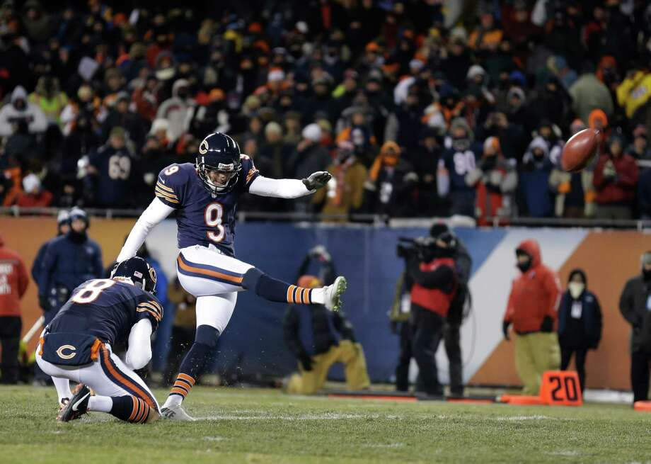 Chicago Bears kicker Robbie Gould (9) kicks an extra point during the first half of an NFL football game against the Dallas Cowboys, Monday, Dec. 9, 2013, in Chicago. (AP Photo/Nam Y. Huh) Photo: Nam Y. Huh, Associated Press / AP