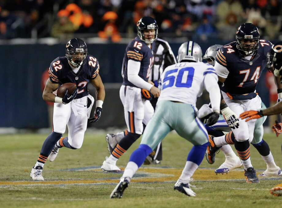 Chicago Bears running back Matt Forte (22) runs the ball during the first half of an NFL football game against the Dallas Cowboys, Monday, Dec. 9, 2013, in Chicago. (AP Photo/Nam Y. Huh) Photo: Nam Y. Huh, Associated Press / AP