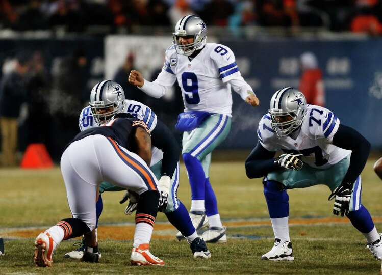 Dallas Cowboys quarterback Tony Romo (9) calls a play from the shotgun position during the first hal