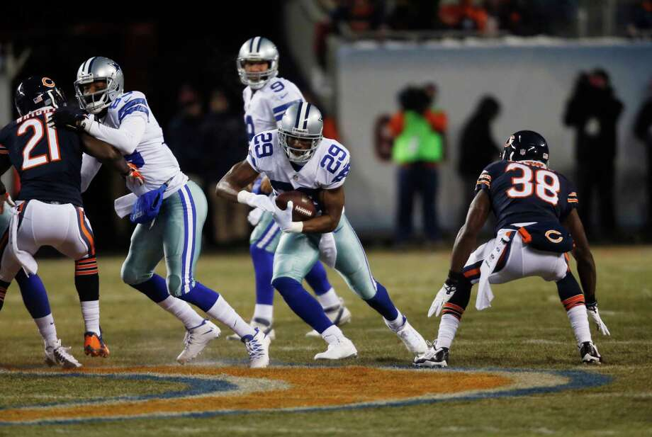 Dallas Cowboys running back DeMarco Murray (29) runs against Chicago Bears cornerback Zack Bowman (38) during the first half of an NFL football game, Monday, Dec. 9, 2013, in Chicago. (AP Photo/Charles Rex Arbogast) Photo: Charles Rex Arbogast, Associated Press / AP