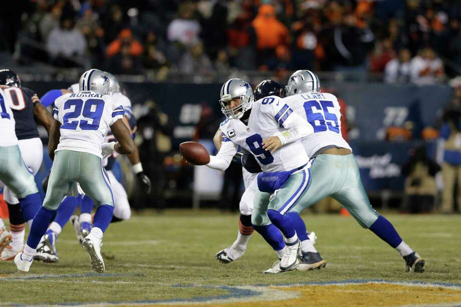 Dallas Cowboys quarterback Tony Romo (9) hands off to running back DeMarco Murray (29) during the first half of an NFL football game against the Chicago Bears, Monday, Dec. 9, 2013, in Chicago. (AP Photo/Nam Y. Huh) Photo: Nam Y. Huh, Associated Press / AP