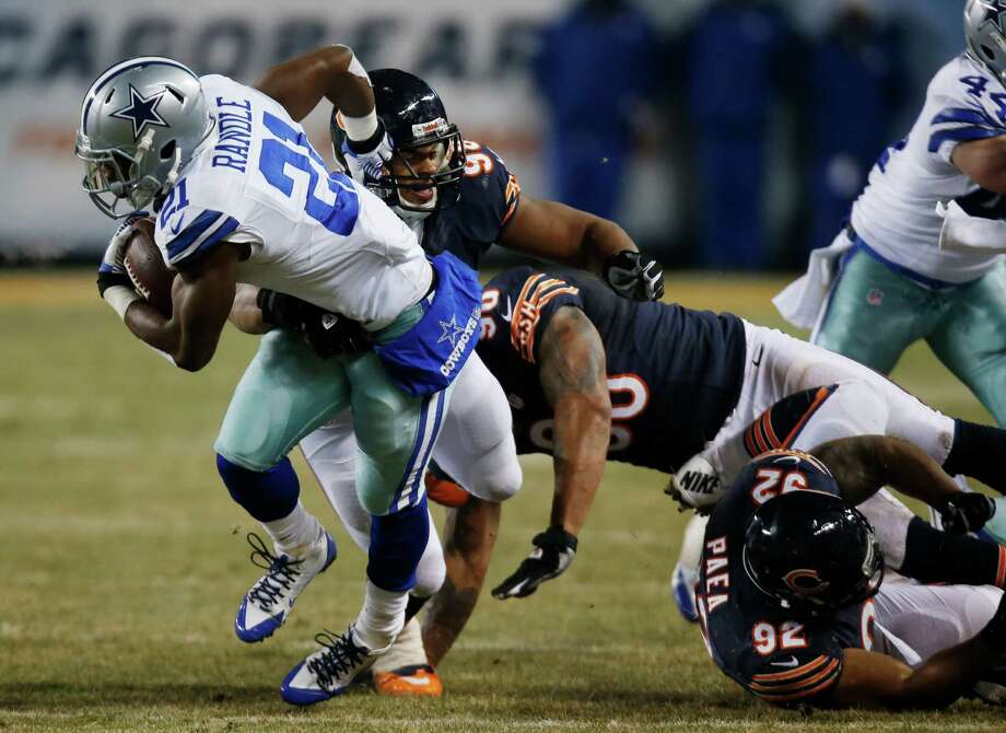 Chicago Bears defensive tackle Corey Wootton (98) tackles Dallas Cowboys running back Joseph Randle (21) during the second half of an NFL football game, Monday, Dec. 9, 2013, in Chicago. (AP Photo/Charles Rex Arbogast) Photo: Charles Rex Arbogast, Associated Press / AP