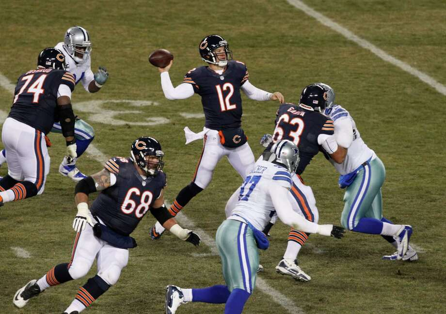 Chicago Bears quarterback Josh McCown (12) passes against the Dallas Cowboys during the first half of an NFL football game, Monday, Dec. 9, 2013, in Chicago. (AP Photo/Kiichiro Sato) Photo: Kiichiro Sato, Associated Press / AP