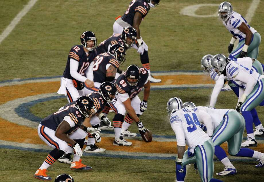 Chicago Bears quarterback Josh McCown (12) calls a play from the line of scrimmage against the Dallas Cowboysduring the first half of an NFL football game, Monday, Dec. 9, 2013, in Chicago. (AP Photo/Kiichiro Sato) Photo: Kiichiro Sato, Associated Press / AP