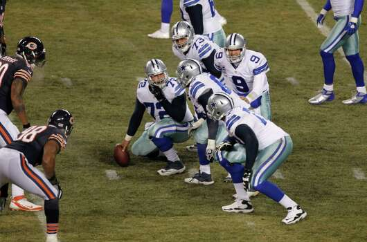 Dallas Cowboys quarterback Tony Romo (9) calls a play from the line of scrimmage during the first half of an NFL football game, Monday, Dec. 9, 2013, in Chicago. (AP Photo/Kiichiro Sato) Photo: Kiichiro Sato, Associated Press / AP