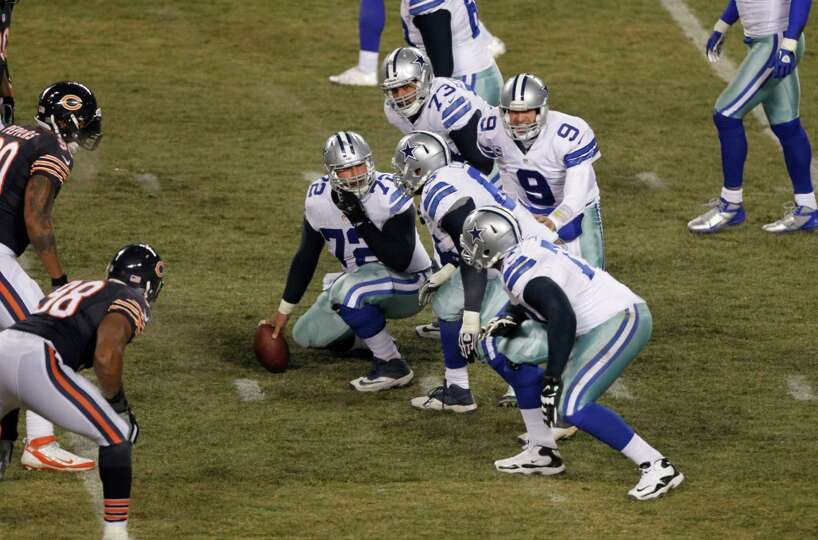 Dallas Cowboys quarterback Tony Romo (9) calls a play from the line of scrimmage during the first ha