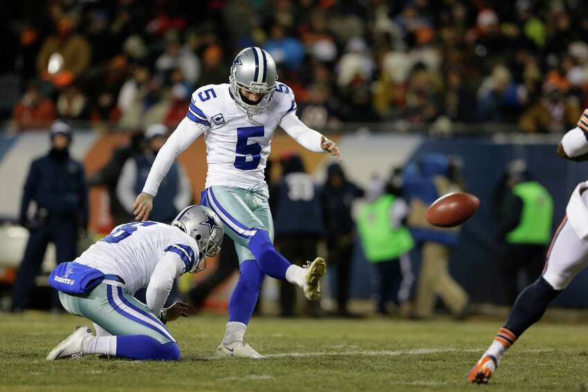 Dallas Cowboys kicker Dan Bailey (5) kicks an extra point during the first half of an NFL football game, Monday, Dec. 9, 2013, in Chicago. (AP Photo/Nam Y. Huh)