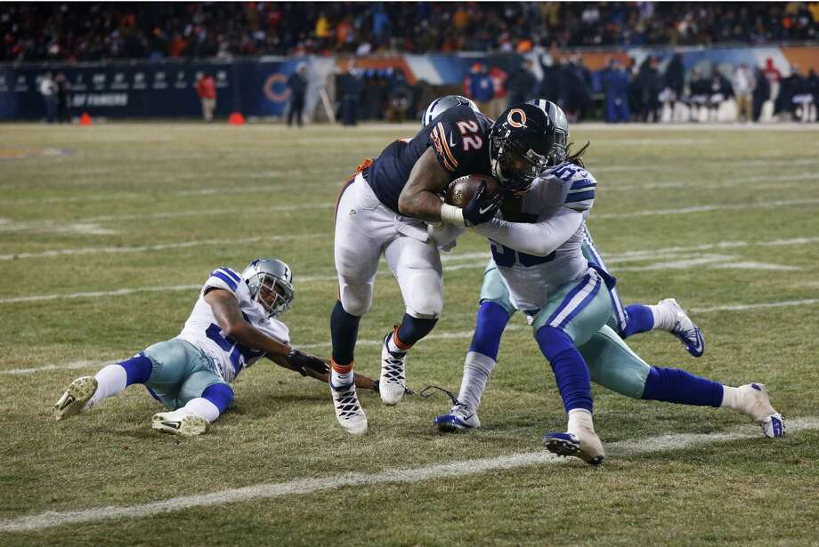 Dallas Cowboys outside linebacker Cameron Lawrence (53) tries to tackle Chicago Bears running back Matt Forte (22) as Forte makes a touchdown run during the second half of an NFL football game, Monday, Dec. 9, 2013, in Chicago. (AP Photo/Charles Rex Arbogast) Photo: Charles Rex Arbogast, Associated Press / AP
