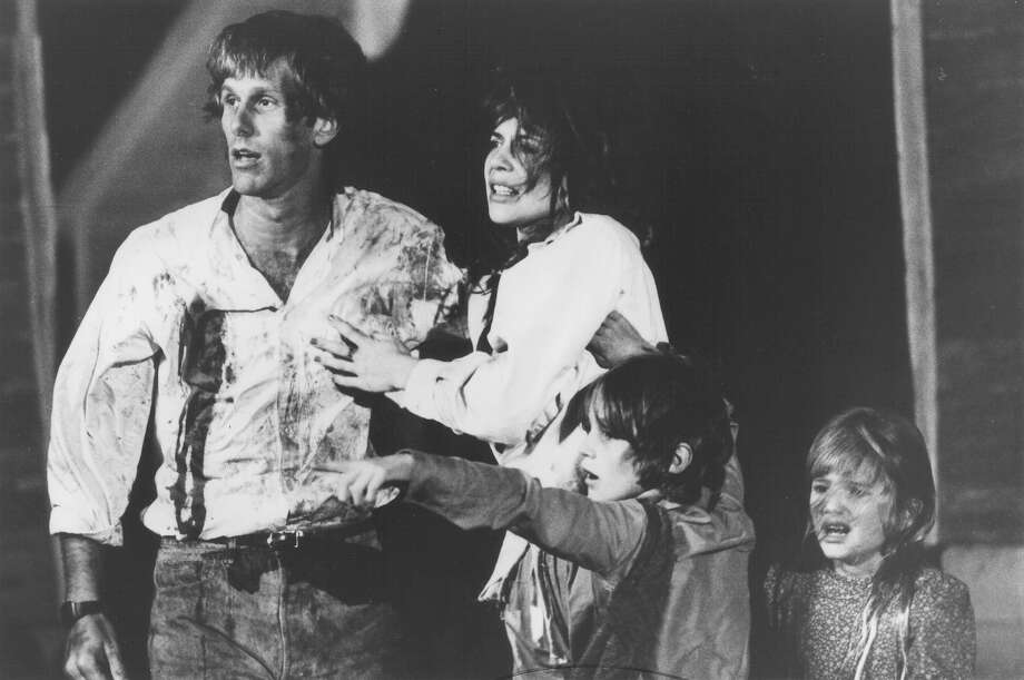 "Peter Horton (from left), Linda Hamilton, Robby Kiger and AnneMarie McEvoy look on in horror as the supernatural being, He Who Walks Behind the Rows, makes his presence known in this scene from ""Stephen King's Children of the Corn."" Photo: New World Pictures"
