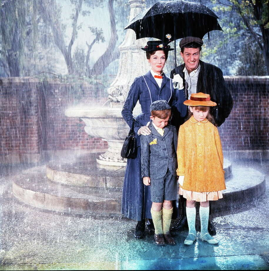 "Julie Andrews as ""Mary Poppins,"" Dick Van Dyke as ""Burt,"" Michael (Matthew Garber) and Jane (Karen Dotrice). Photo: Disney, 1964,2013"