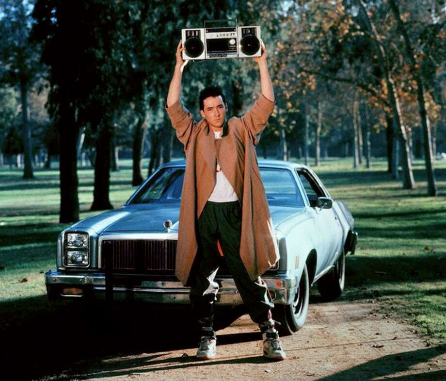 "Say Anything... (1989): When Lloyd Dobler (John Cusack) tries to win back the affections of Diane Court (Ione Skye) by hoisting a boom-box over his head and blasting ""In Your Eyes"" by Peter Gabriel. Watch the clip. Photo: 20th Century Fox"