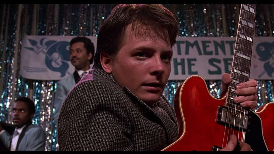 "Back to the Future (1985): When Marty McFly (Michael J. Fox) blows the youth of 1955 away with Chuck Berry's 1958 hit ""Johnny B. Goode"" (and a bit of Eddie Van Halen style guitar pyrotechnics). Watch the clip. Photo: Universal"