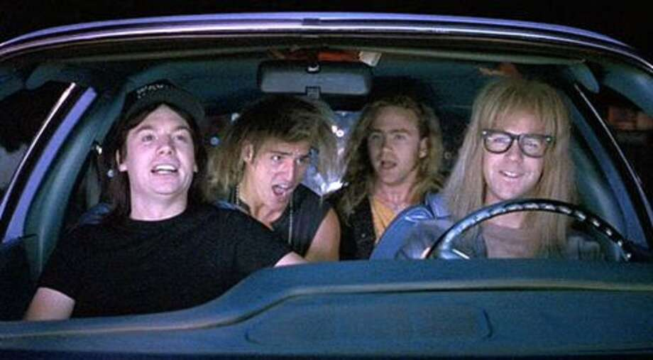 "Wayne's World (1992): When Wayne (Mike Myers) and Garth (Dana Carvey) and friends rock out in the car to Queen's ""Bohemian Rhapsody.""  Watch the clip. Photo: Paramount Pictures"