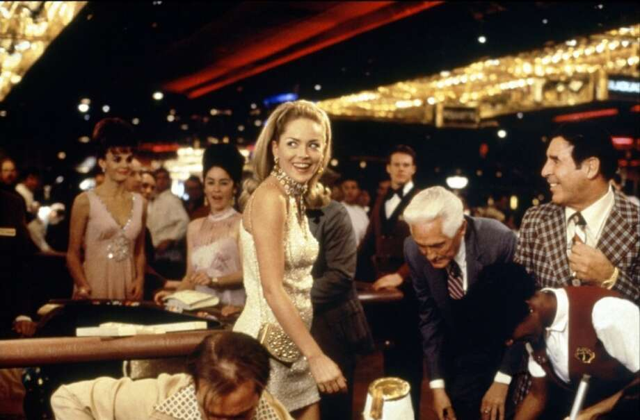 "Casino (1995): When Ace (Robert De Niro) falls for Ginger (Sharon Stone) at the craps table to the sound of Mickey and Sylvia's ""Love Is Strange."" Watch the clip. Photo: Universal"