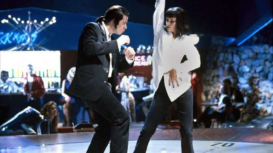 "Pulp Fiction (1994): When Vincent Vega (John Travolta) and Mia Wallace (Uma Thurman) do the twist at Jack Rabbit Slim's to Chuck Berry's ""You Never Can Tell.""  Watch the clip. Photo: Miramax"
