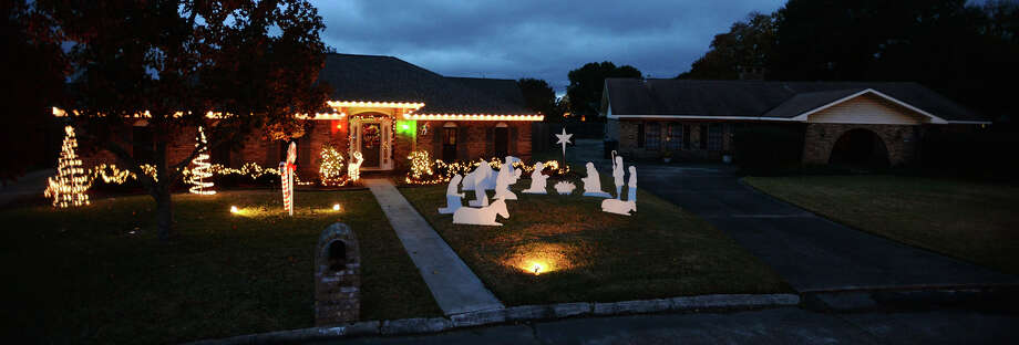 While some homeowners choose to participate in the Lolicane Lane neighborhood light display, others decide to not deal with the seasonal hassle. Photo taken Jake Daniels/@JakeD_in_SETX Photo: Jake Daniels / ©2013 The Beaumont Enterprise/Jake Daniels