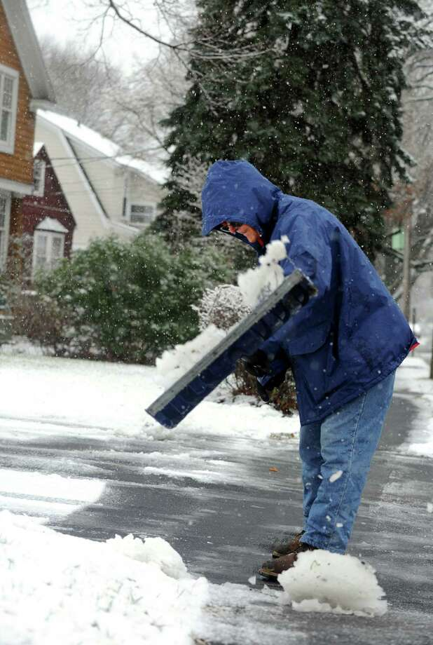 Bill Dwinells shovels snow on South Benson Road in Fairfield, Conn. on Tuesday, Dec. 10, 2013 as a morning storm came through the area. Wednesday's weather is expected to be sunny and seasonably cold. Photo: Cathy Zuraw / Connecticut Post