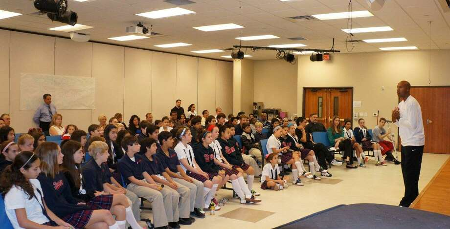 St. George Episcopal SchoolÕs Fellowship of Christian Athletes President Natalie Velez and her mother Tracey Velez arranged for Bruce Bowen, former Spur, to come visit the Castle Hills campus. Bowen spoke about working as a team and having a specific role on the team. Photo: Courtesy Photo