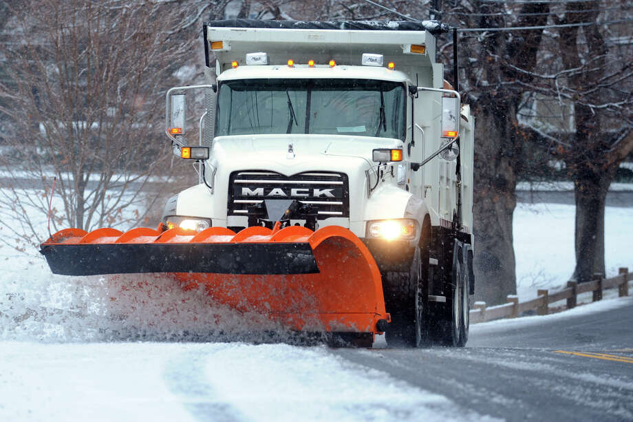 A Town of Stratford Public Works truck plows during the first snowfall of the season Dec. 10, 2013. Photo: Ned Gerard / Connecticut Post