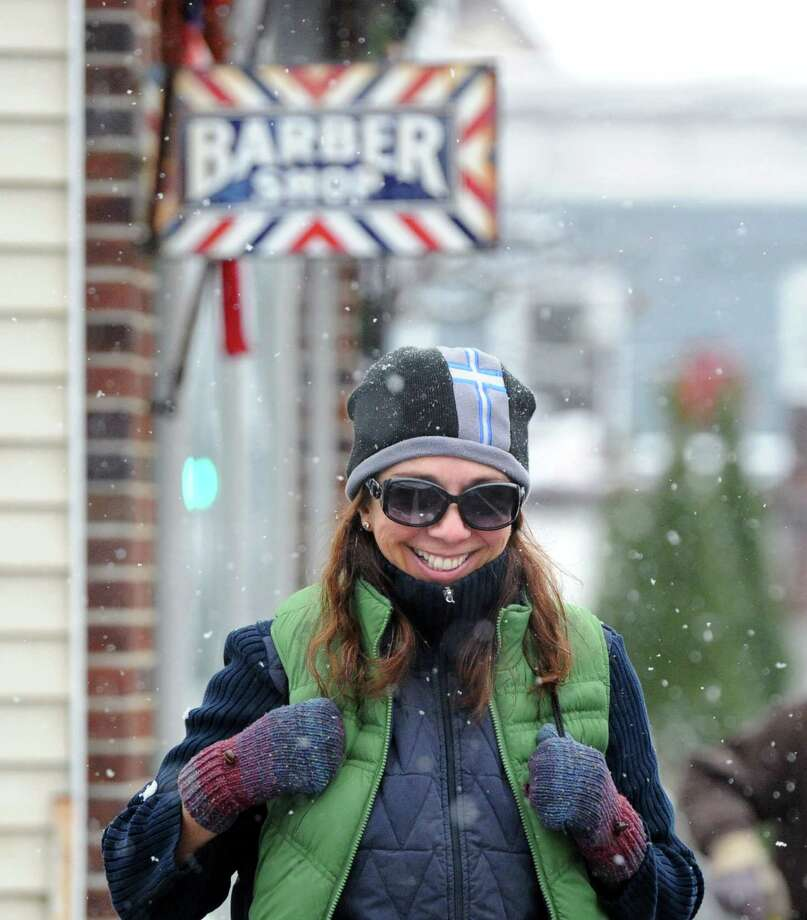 Mercedes Bassani of Greenwich smiles while walking on View Street during a morning snow storm in Greenwich, Tuesday, Dec. 10, 2013. Photo: Bob Luckey / Greenwich Time