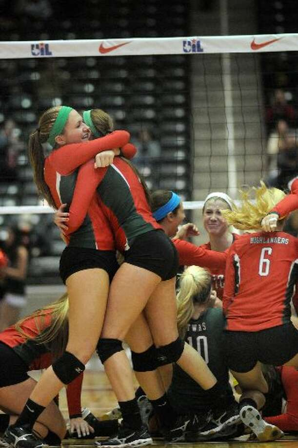 The Woodlands volleyball team celebrates a state title.