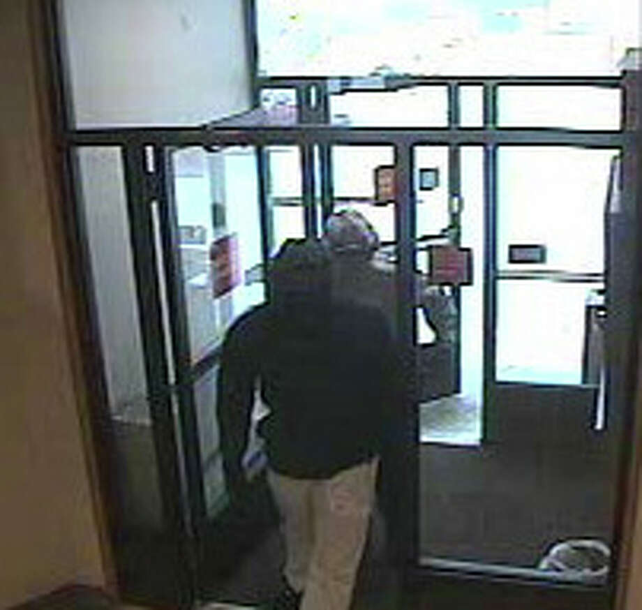 Security camera photo of suspects in Shelton bank robbery on Dec. 10, 2013 Photo: Contributed Photo / Connecticut Post Contributed