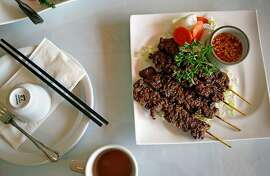 The Sachkor Ang, or beef skewers, at Phnom Penh restaurant in Oakland, Calif., on Friday, December 6, 2013.
