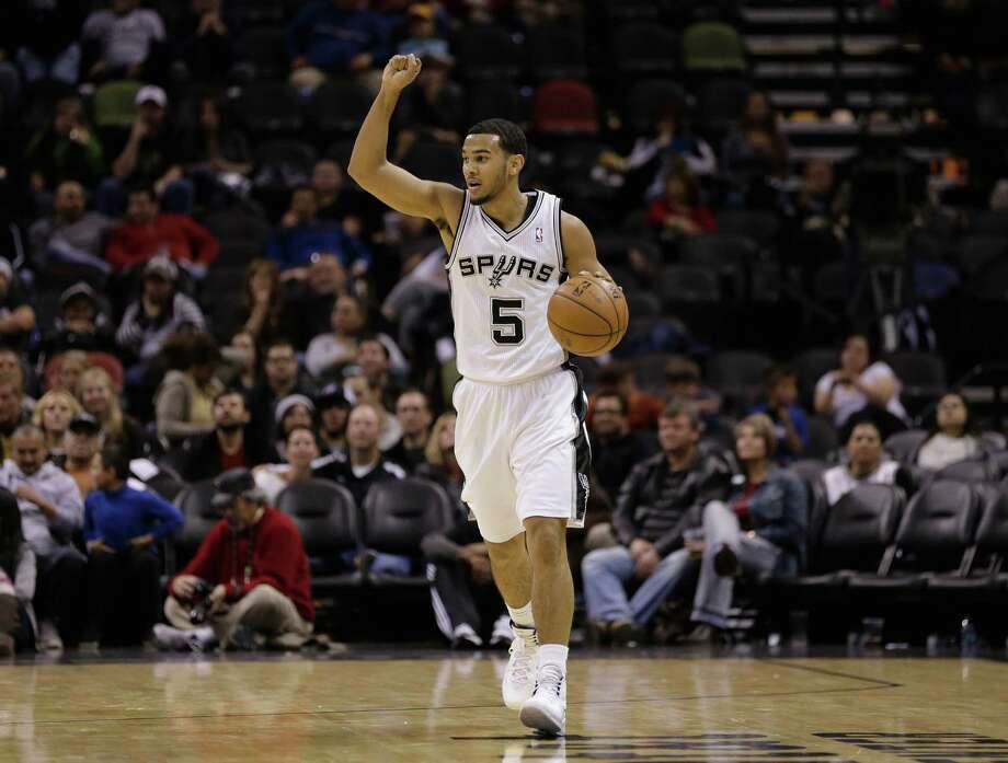 San Antonio Spurs' Cory Joseph brings the ball up court against the New Orleans Pelicans during the second half of an NBA basketball game, Monday, Nov. 25, 2013, in San Antonio. San Antonio won 112-93. (AP Photo/Eric Gay) Photo: Eric Gay, Associated Press / AP