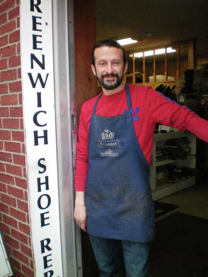 George Togridis at the entrance of his Greenwich Shoe Repair store off East Elm Street. Photo: Contributed Photo / Greenwich Citizen
