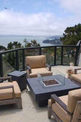 A steel and glass railing minimally obstructs the sweeping views from this Tiburon deck.Ê