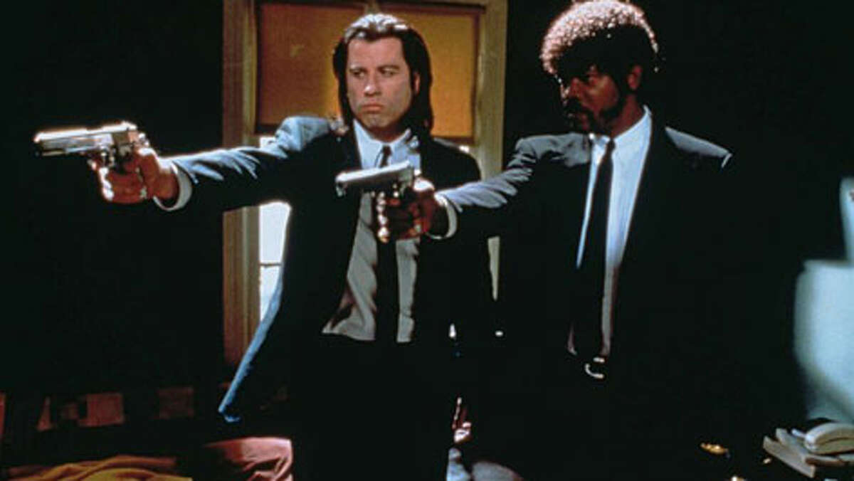 Actors John Travolta (left) as Vincent Vega and Samuel L. Jackson as Jules Winnfield in a scene from