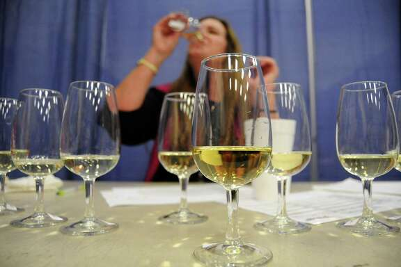 Judge Karin Violante samples a white wine at the Houston Livestock Show and Rodeo's wine competition.