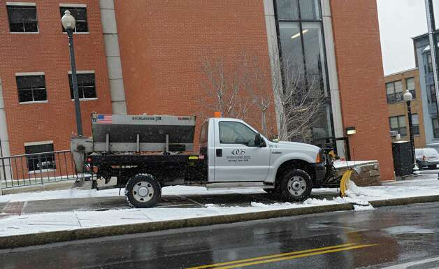 An OGS truck clears snow from a sidewalk in front on Madison Ave. Tuesday, Dec. 10, 2013, in Albany, N.Y. (Lori Van Buren / Times Union) Photo: Lori Van Buren / 00024968A
