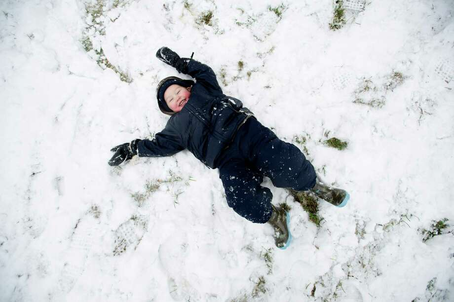 Matthew Foster, 2, makes a snow angel at Pemberwick Park in Greenwich, Conn., on Tuesday, December 10, 2013. Photo: Lindsay Perry / Stamford Advocate