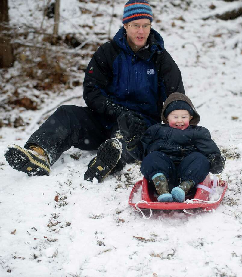 Matthew Foster, 2, sleds with his father, Tim, at Pemberwick Park in Greenwich, Conn., on Tuesday, December 10, 2013. Photo: Lindsay Perry / Stamford Advocate