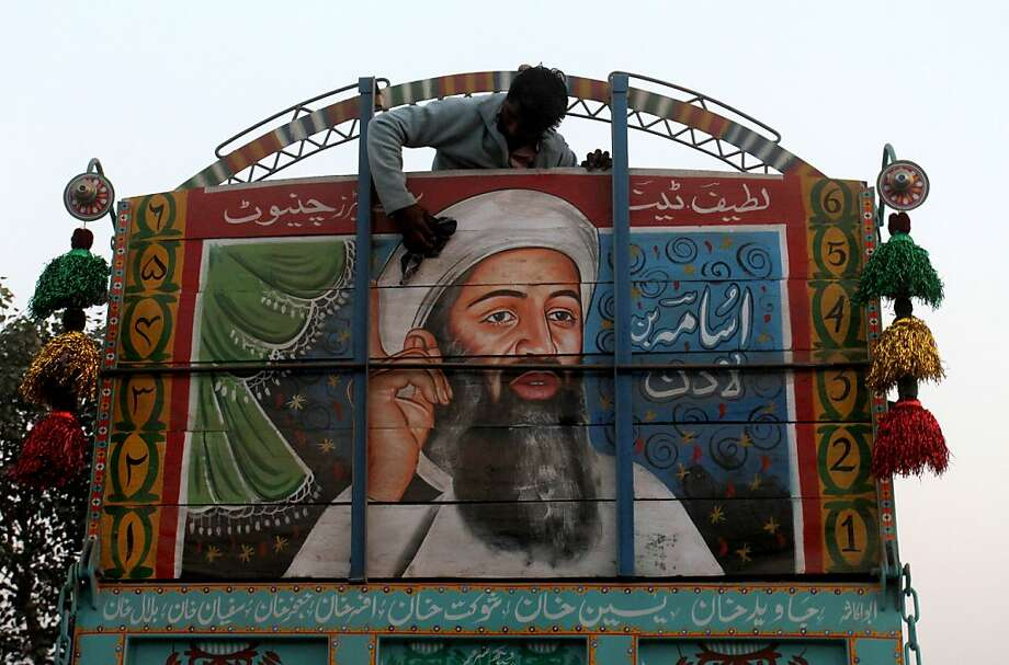 Jihad Van Lines:Osama bin Laden lives on as a mural on the back of a panel truck in Lahore, Pakistan. Photo: K.M. Chaudary, Associated Press