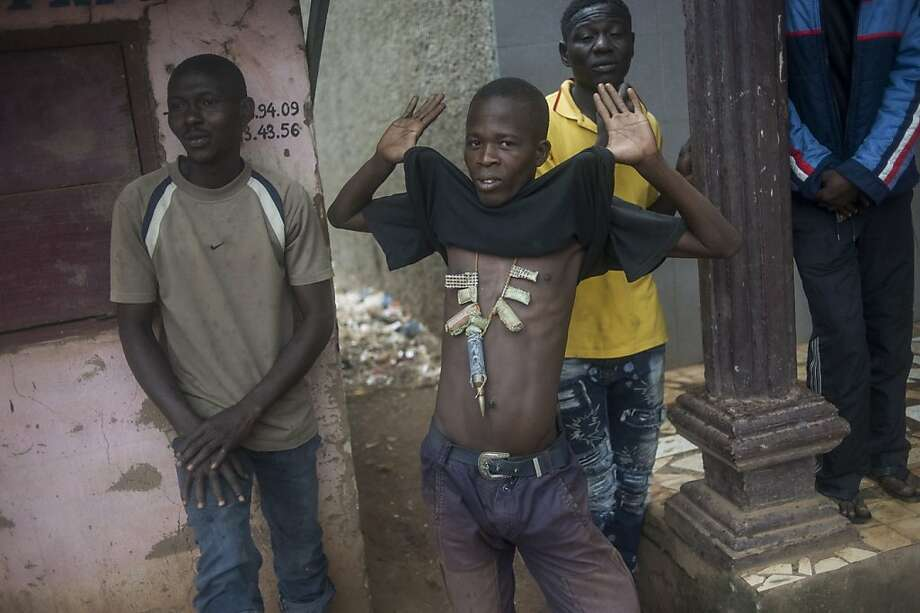'Bulletproof vest':A resident of the Combattant neighborhood of Banqui, Central African Republic, shows charms that he believes protects him from bullets. French soldiers began disarming gunmen in the area after a surge in sectarian violence that has claimed hundreds of lives and terrified inhabitants. Photo: Fred Dufour, AFP/Getty Images