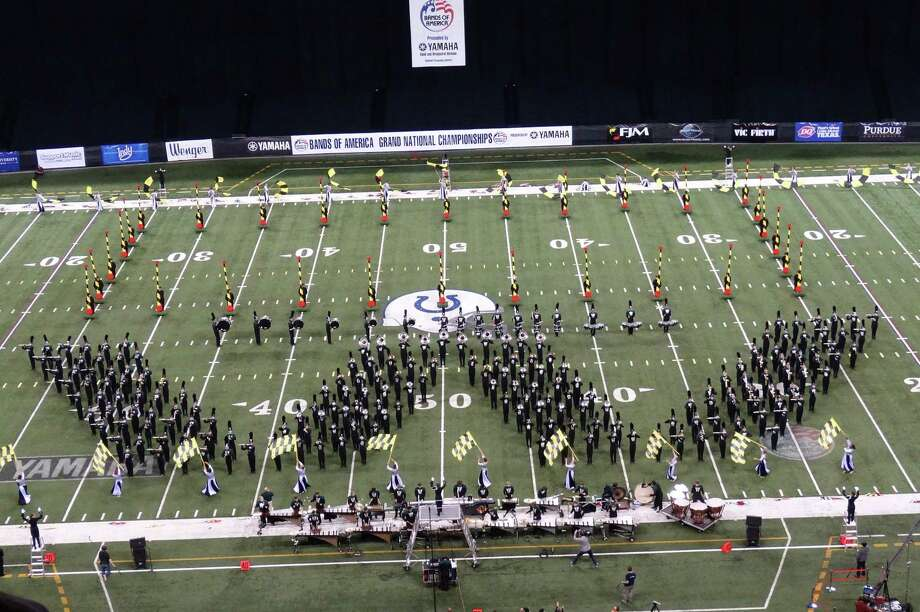 The Woodlands High School band performs its signature W on the field. The band won top honors at the Bands of America Grand National Championship on Nov. 16. Photo: Courtesy