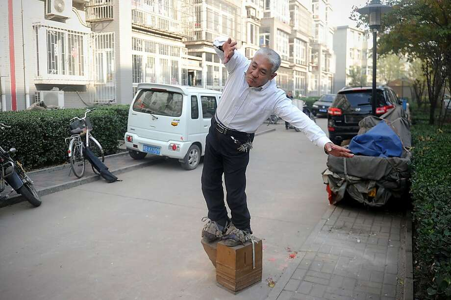 Strangest. Hemorrhoid cure. Ever: Zhang Fuxing takes daily walks in his iron shoes, but at 440 pounds per shoe, he doesn't go far. In a minute of walking, the 52-year-old factory worker of Tangshan, China, manages only 10 paces. Zhang, who attributes his ability to move the heavy blocks to the spiritual martial art of Qigong, says the exercise cured his back pain and hemorrhoids. Photo: Wang Zhao, AFP/Getty Images