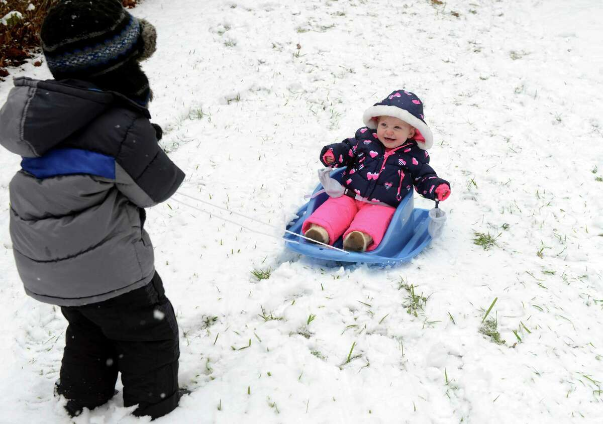 Children play in the snow in Derby, Conn. Tuesday, Dec. 10. 2013.